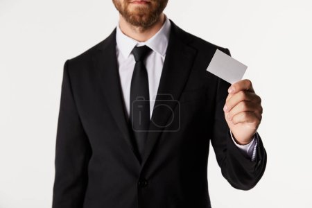 cropped image of businessman empty visit card isolated on white background