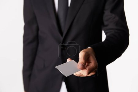 Photo for Cropped image of businessman giving empty business card isolated on white background - Royalty Free Image