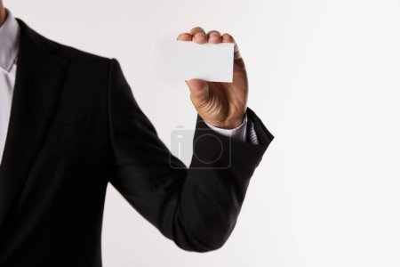 cropped image of businessman holding blank visit card isolated on white background