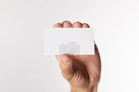 cropped image of businessman showing empty visit card isolated on white background