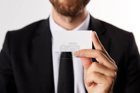 partial view of businessman showing blank business card isolated on white background
