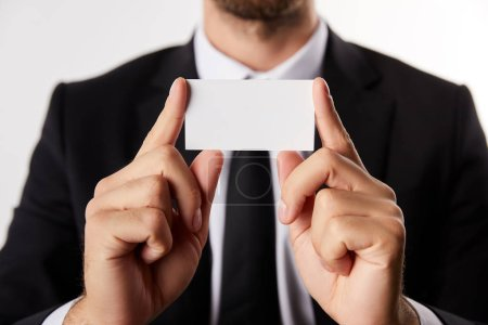 partial view of businessman presenting blank business card isolated on white background