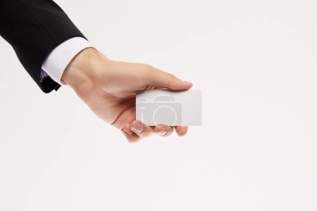 Photo for Cropped image of businessman showing empty business card isolated on white background - Royalty Free Image