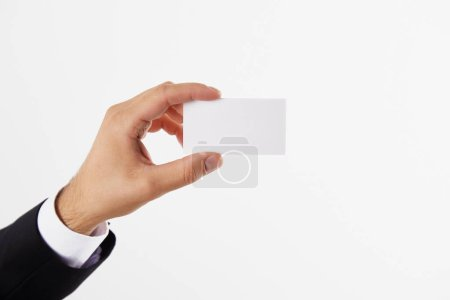 cropped image of  businessman presenting blank visit card isolated on white background