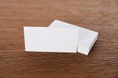 selective focus of stack of blank business cards at wooden table