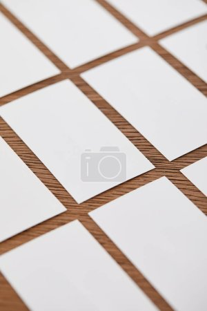 selective focus of set of blank business cards at wooden table