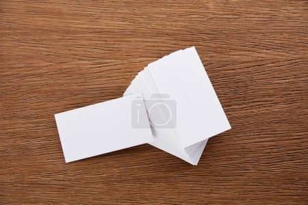 close up view of stack of blank business cards at wooden table