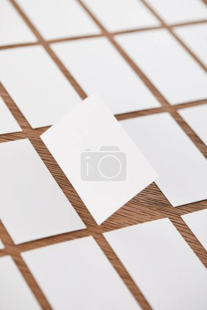 selective focus of set of empty business cards at wooden table