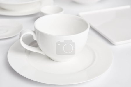 selective focus of plates and bowl on white tabletop
