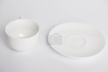 Photo for Close up view of plate and bowl on white table, minimalistic concept - Royalty Free Image