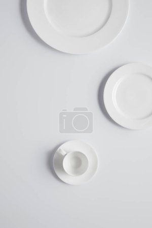 elevated view of different plates and cup on white table