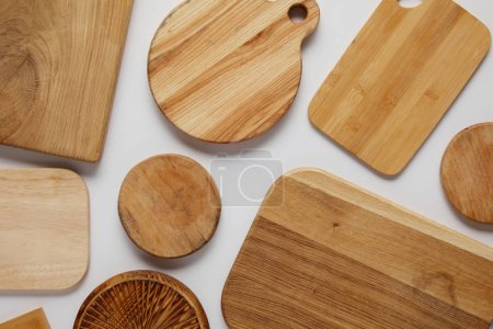 top view of various wooden cutting boards on white table