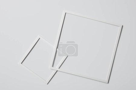 top view of square frames on white surface