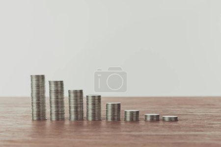 stacks of coins on wooden table, saving concept