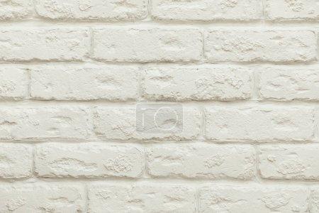 Photo pour Vue rapprochée du fond blanc vide du mur de briques - image libre de droit