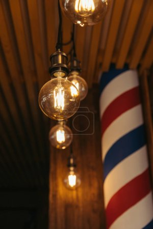close-up view of illuminated light bulbs in stylish loft interior