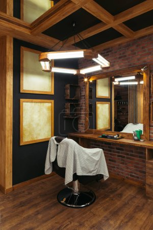 modern empty barbershop interior with chair, mirror and lamps