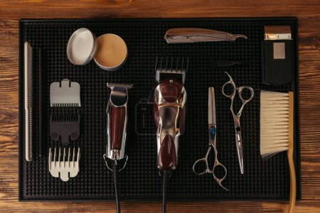 top view of set of various professional barber tools in hair salon