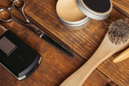 close-up view of professional barber tools on wooden surface
