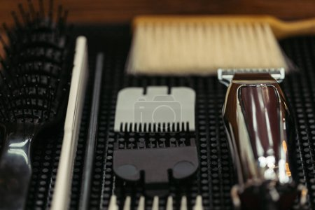 close-up view of comb, brushes and electric clipper in barbershop