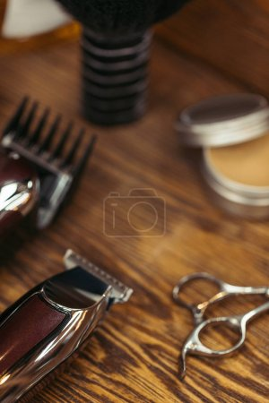 close-up view of various barber tools on wooden table