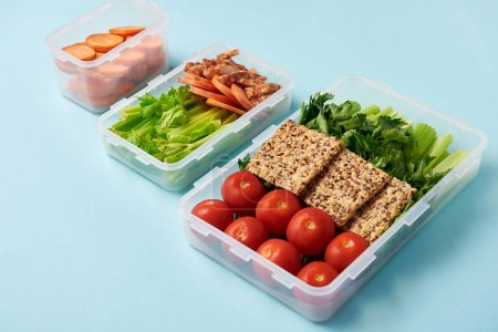 close up view of arrangement of food containers full of fresh healthy food background