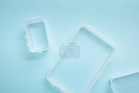 top view of empty lunch boxes isolated on blue