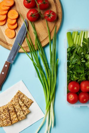 flat lay with knife and healthy food composition isolated on blue