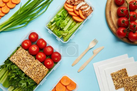 flat lay with healthy food composition isolated on blue