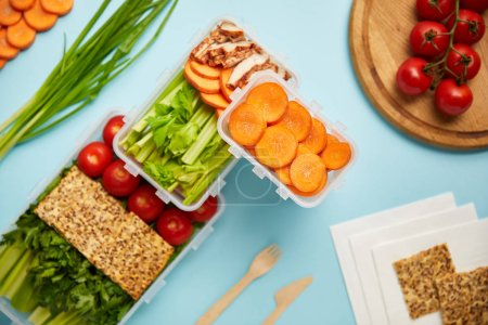 flat lay with cutlery and healthy food composition isolated on blue