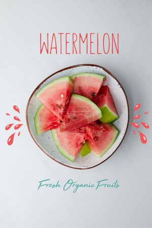 "top view of fresh watermelon pieces in bowl on white tabletop, with ""watermelon fresh organic fruits"" lettering"