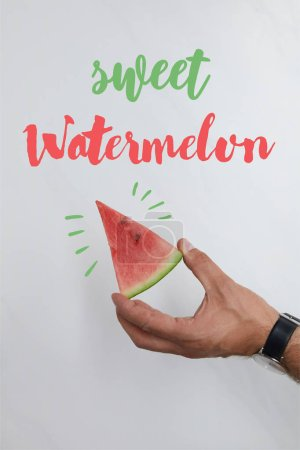 "cropped shot of man holding watermelon piece in hands on white, with ""sweet watermelon"" lettering"