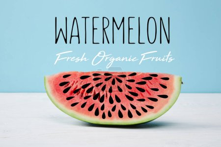 "red fresh watermelon slice on white surface on blue background, with ""watermelon fresh organic fruits"" lettering"