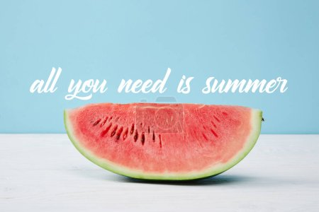"fresh juicy watermelon slice on white surface on blue background, with ""all you need is summer"" inspection"