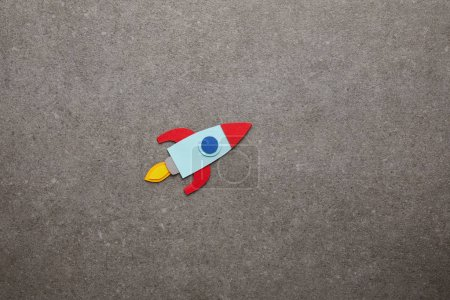 Photo for Colorful handmade rocket on gray background - Royalty Free Image