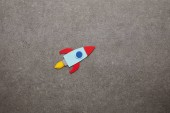 colorful handmade rocket on gray background