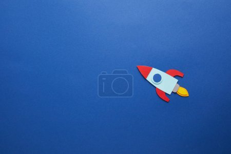 Photo for Creative rocket on blue paper background - Royalty Free Image