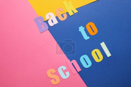 colorful back to school lettering on creative paper background