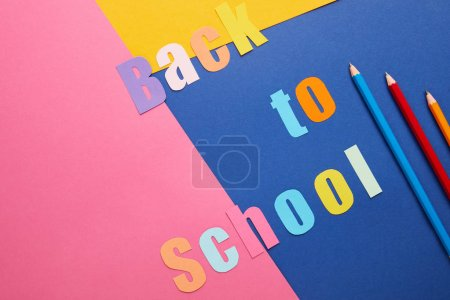 back to school lettering with pencils on creative paper background