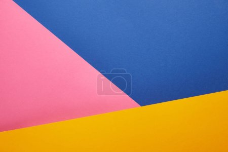 geometrical texture with blue, pink and yellow papers