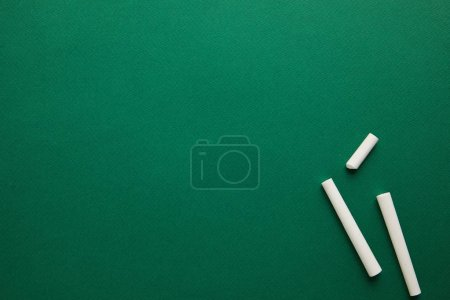 Photo for Top view of white chalks on green blackboard - Royalty Free Image