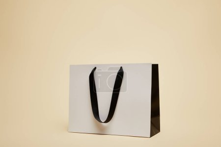 Photo for One white shopping bag isolated on beige - Royalty Free Image