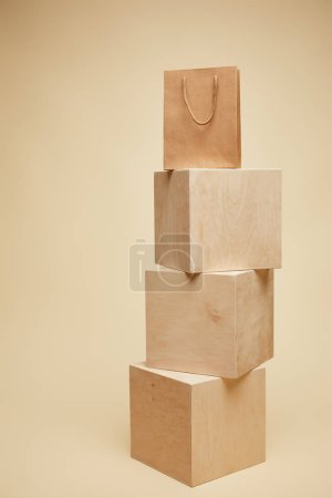 one shopping bag on wooden cubes isolated on beige