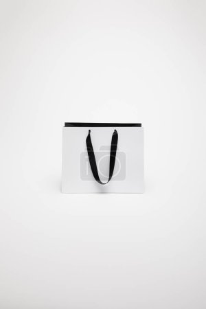 Photo for One black and white paper shopping bag isolated on white - Royalty Free Image