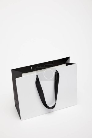 Photo for One open black and white shopping bag isolated on white - Royalty Free Image