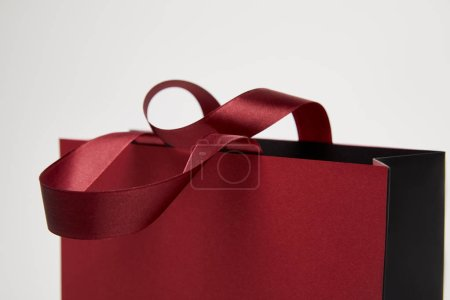 selective focus of one burgundy shopping bag isolated on white