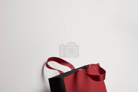 Photo for One beautiful burgundy shopping bag on white - Royalty Free Image