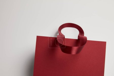 Photo for One burgundy paper shopping bag on white - Royalty Free Image