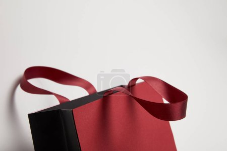 Photo for One new burgundy shopping bag on white - Royalty Free Image
