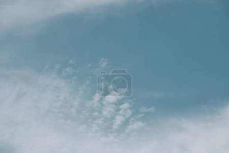 full frame image of cloudy blue sky background